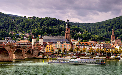Heidelberg along the Neckar River, Germany. Photo via Flickr:Alex Hanoko