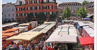 Market in Ludwigsburg, Germany along the Neckar and Mainz Rivers. Photo via Flickr:Jorbasa Fotografie