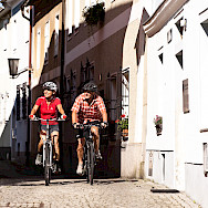 Enjoying a bike ride through the medieval streets of Austria on the Danube Bike Tour.