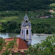 Danube River flowing through Dürnstein, a popular wine-growing town in the Wachau region. Flickr:jay8085