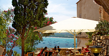 Scenic dining by the port of Calvi, Corsica. Photo via Flickr:philippe amiot