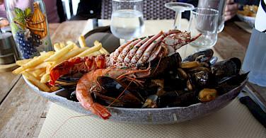 Seafood in Saint Florent on Corsica Island in the Mediterranean. Photo via Flickr:michimaya