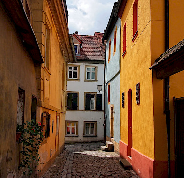Cobblestone streets in medieval Bamberg on the Regnitz River, Germany. Photo via Flickr:mos
