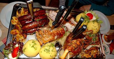 Bambergpfanne! Meat, potatoes and beer are German staples, and biker's fuel. Photo via Flickr:Vladislav Bezrukov