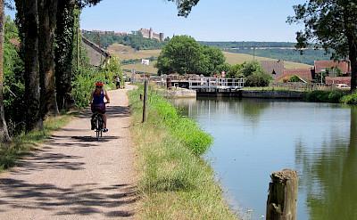 Biking along the river in Burgundy, France.