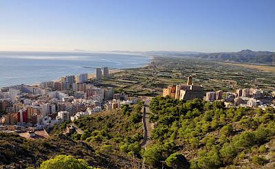 Biking seaside in Cullera, Spain. Photo via Flickr:Frayle