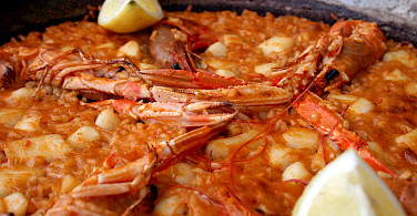Paella de Marisco in Valencia, Spain. Great bike tour fuel! Photo via Flickr:Diego