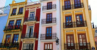 Enjoying a bike ride through Valencia to admire architecture. Photo via Flickr:Juan Antonio F. Segal