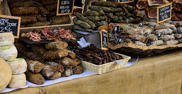 Salami et al at the Ajaccio Market, Corsica, France. Photo via Flickr:Vogyages Lambert