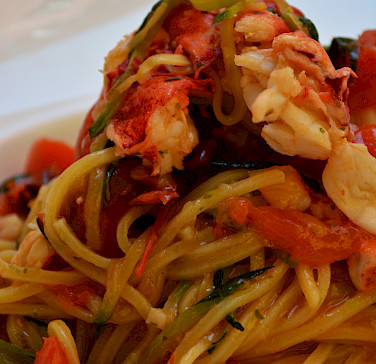 Seafood pasta in Parma, Emilia-Romagna, Italy. Photo via Flickr:Pug Girl