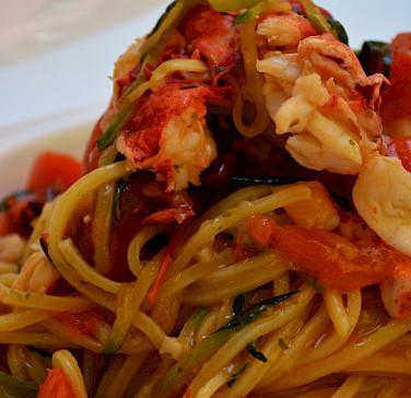 Seafood pasta in Parma, Emilia-Romagna, Italy. Photo via Flickr:Pug Girl
