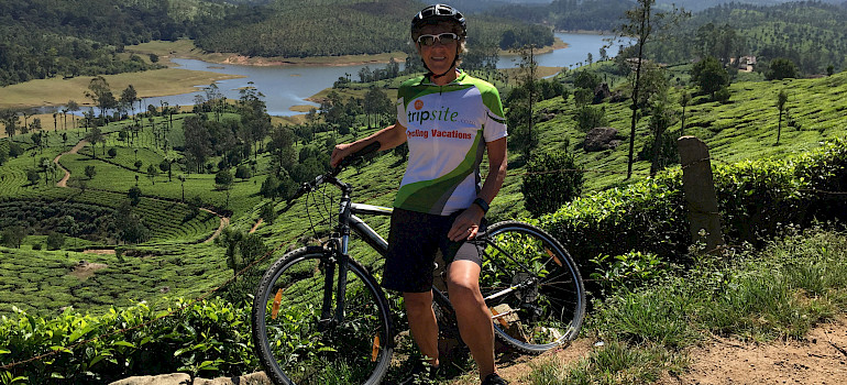 Hennie biking among the tea plantations in Munnar, Kerala, India.