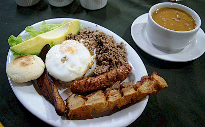 "Traditional ""bandeja paisa"" in Medellín, department Antioquira, Colombia. Photo via Wikimedia Commons:Dtarazona"