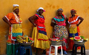 Women selling watermelon in Colombia. Photo via Flickr:Luz Adriana Villa