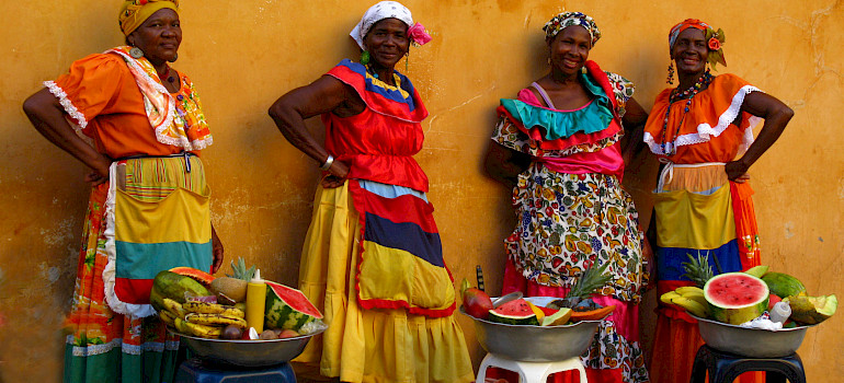 Women selling watermelon in Colombia. Photo via Flickr:Luz Adriana Villa