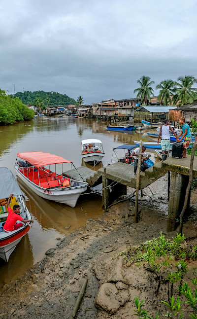 Boats in Nuquí on the Pacific Ocean, Colombia. Photo via Flickr:Serge