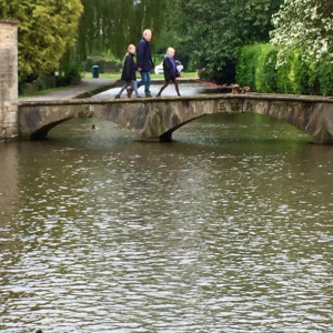 One of Many Bridges That Spans the River Windrush in Bourton on the Water, England
