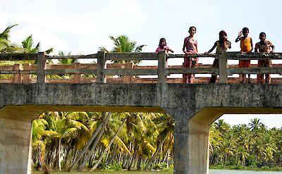 Kids on bridge over Periyar River in Kerala, India. Flickr:Tanmayee Deshprabhu