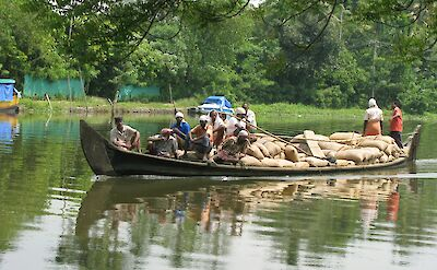 Rice sacks in Kumarakom, Kerala, India. Flickr:Rajaneesh