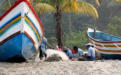 Fixing fishing nets in Kerala, India. Flickr:Andy Kaye