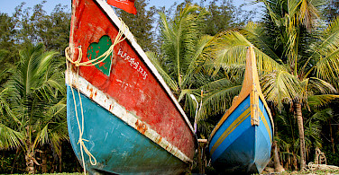 Boats on Marari Beach, Kerala, India. Photo via Flickr:Andy Kaye