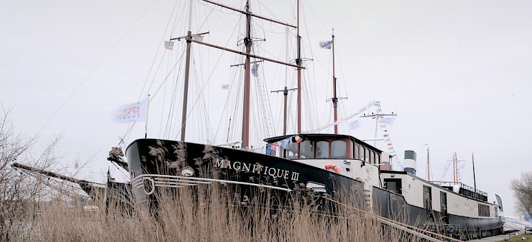 Magnifique III docked - Bike & Boat Tours