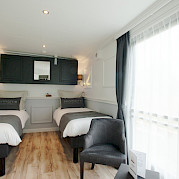 Magnifique III Upper Deck Suite Beds - Bike & Boat Tours