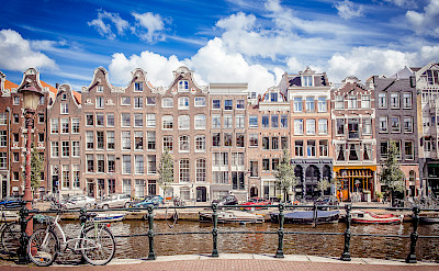 Gorgeous facades and canals in Amsterdam, North Holland, the Netherlands. Photo via Flickr:Andres Nieto Porras