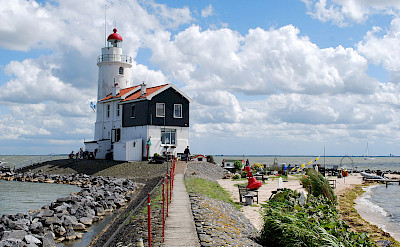 Lighthouse in Marken, North Holland, the Netherlands. Photo via Wikimedia Commons:Rob Koster