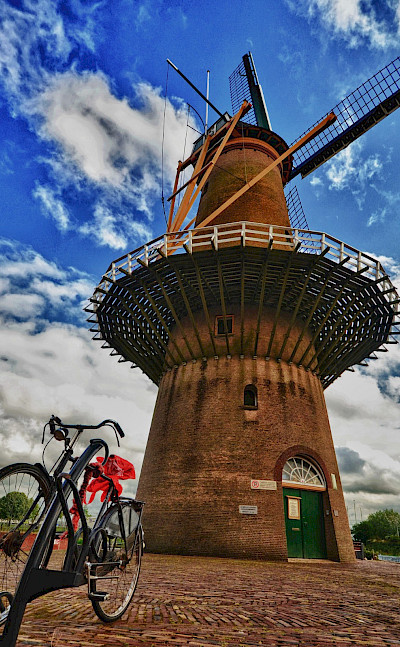 Bike rest at windmill in Rotterdam, South Holland, the Netherlands. Flickr:Luca Bolattiguzzo