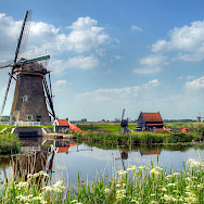 Windmills (19) abound in Kinderdijk, South Holland, the Netherlands. Photo via Flickr:John Morgan