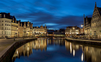 Ghent aglow at night in Belgium. Photo via Flickr:Jiuguang Wang