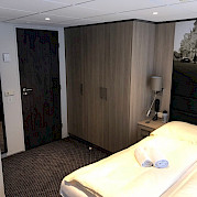 Closet in the suite cabin on the Arlene II | Bike & Boat Tours