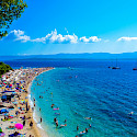 Sunbathing on the beach of Brac Island, Croatia. Flickr:Nick Savchenko