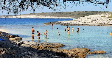 Sunbathing on Hvar Island, Dalmatia, Croatia. Photo via Flickr:Antonio Castagna
