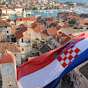 Croatian flag flying in Trogir, Dalmatia. Photo via Flickr:Jeremy Couture