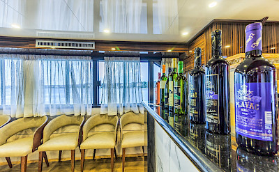 Saloon and bar area - New Star | Bike & Boat Tours