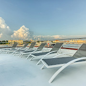 Sun deck and chairs for lounging aboard the New Star