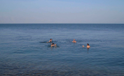 Swimming (well... floating) in the Dead Sea.