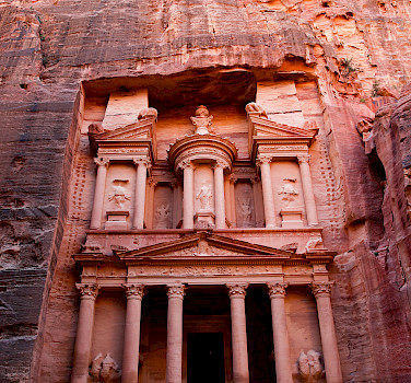 Al-Khazneh, is one of the most elaborate temples in the ancient Arab Nabatean Kingdom city of Petra. As with most of the other buildings in this ancient town, including the Monastery, this structure was carved out of a sandstone rock face.