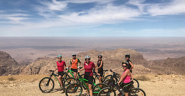 Tripsite Traveler, Casey G. posing with her group during a nice bike ride in Jordan!