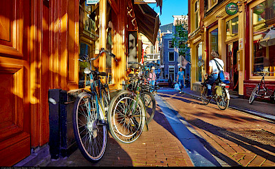 Bicycling through Amsterdam, North Holland, the Netherlands. Flickr:Moyan Brenn
