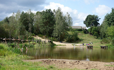 Picnic at the wooden bridge in Trzy Morgi, Poland. Photo via Tour Operator