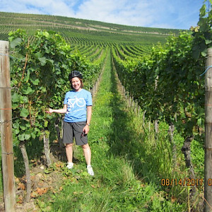 Posing for a picture in vineyard