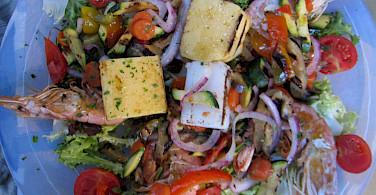 Seafood laden Mediterranean lunch in Italy. Photo via Flickr:Karne