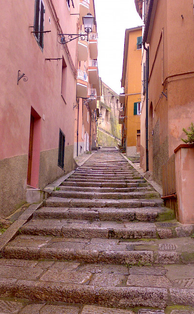 Street in Porto Santo Stefano on the Tuscan Coast, Italy. Photo via Wikimedia Commons:Ceppicone