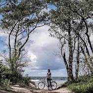 Biking the Curonian Spit in Lithuania. Photo via Eduard V Kurganov