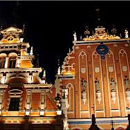 House of the Blackheads at night in Riga, Latvia. Photo via Flickr:Jorbasa Fotografie