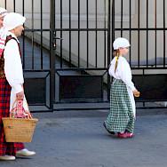 Ladies in Vilnius, Lithuania. Photo via Flickr:Andreas Lehner