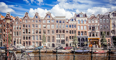 Canals and canal boats and bikes in Amsterdam, North Holland, the Netherlands. Flickr:Andres Nieto Porras